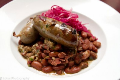 House-made boudin over confit pork, smokey beans, topped with pickled red cabbage