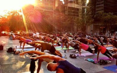 Yogis take over the Comcast Center Thursday evenings // Photo via Urban Yoga Philly