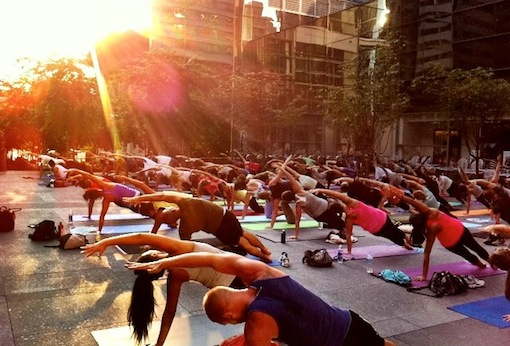 Yogis take over the Comcast Center Thursday evenings // Photo via Urban Yoga Philly