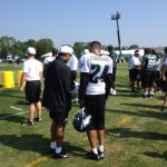 Philadelphia Eagles defensive coordinator Juan Castillo talks to cornerback Nnamdi Asomugha.