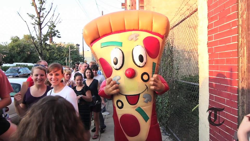 No better day to wear your pizza costume than the opening of Pizza Brain. - Temple News