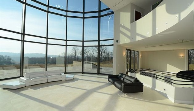 Spectacular views at this West Chester property come courtesy of the aluminum and glass curved wall.