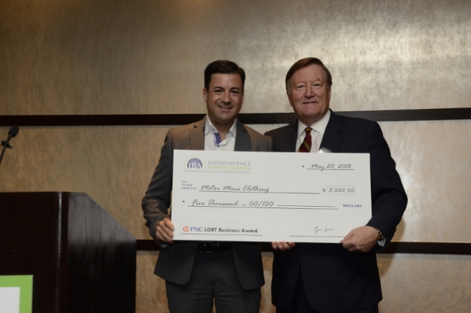 Metro Men's Clothing owner Tom Longo Jr. (left) receives last year's $5K grant from PNC's Bill Mills.