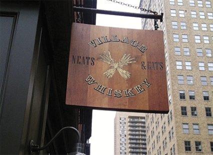 village_whiskey_sign