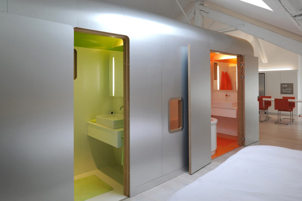 A green bathroom and an orange bathroom.