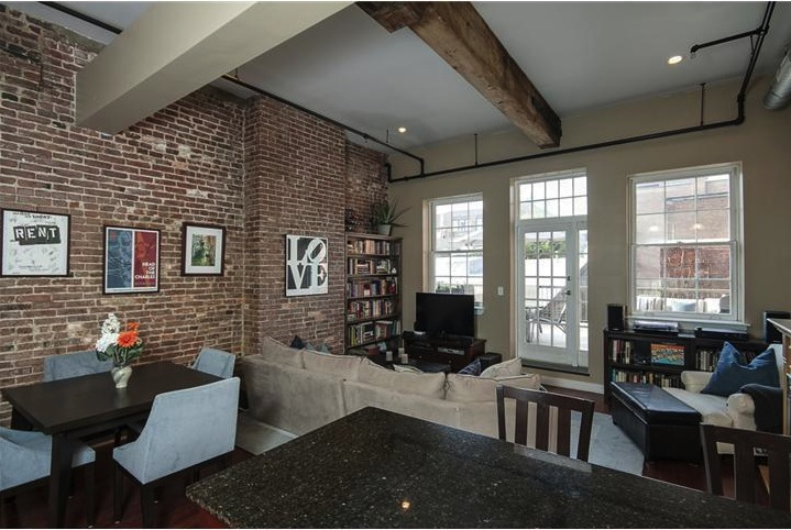An exposed brick wall at 103-7 Church St., #8, Philadelphia.