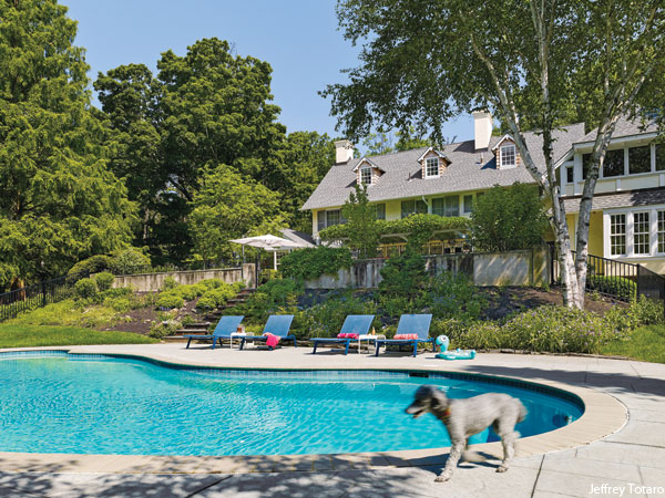 Photograph by Jeffrey Totaro for Philadelphia magazine. A Mona Ross Berman designed home in Chestnut Hill, Pennsylvania. Backyard pool.