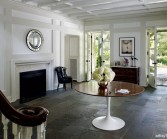 Photograph by Jeffrey Totaro for Philadelphia magazine. A Mona Ross Berman designed home in Chestnut Hill, Pennsylvania. Entrance to home with table and chair.