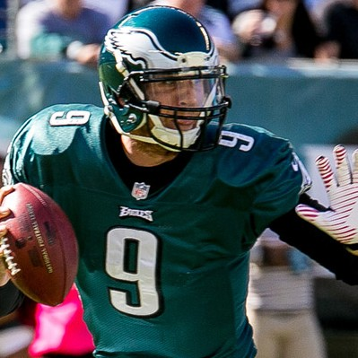 Eagles QB Nick Foles evades the Cowboys' rush. 10/20/13