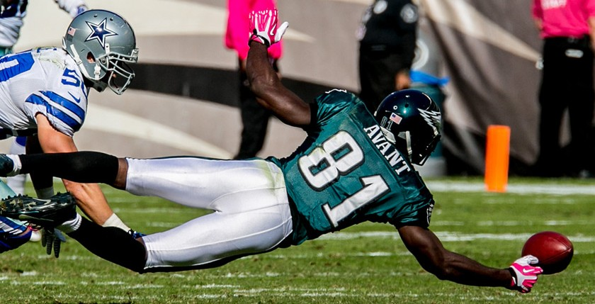 Eagles WR Jason Avant dives for a pass against the Cowboys. 10/20/13