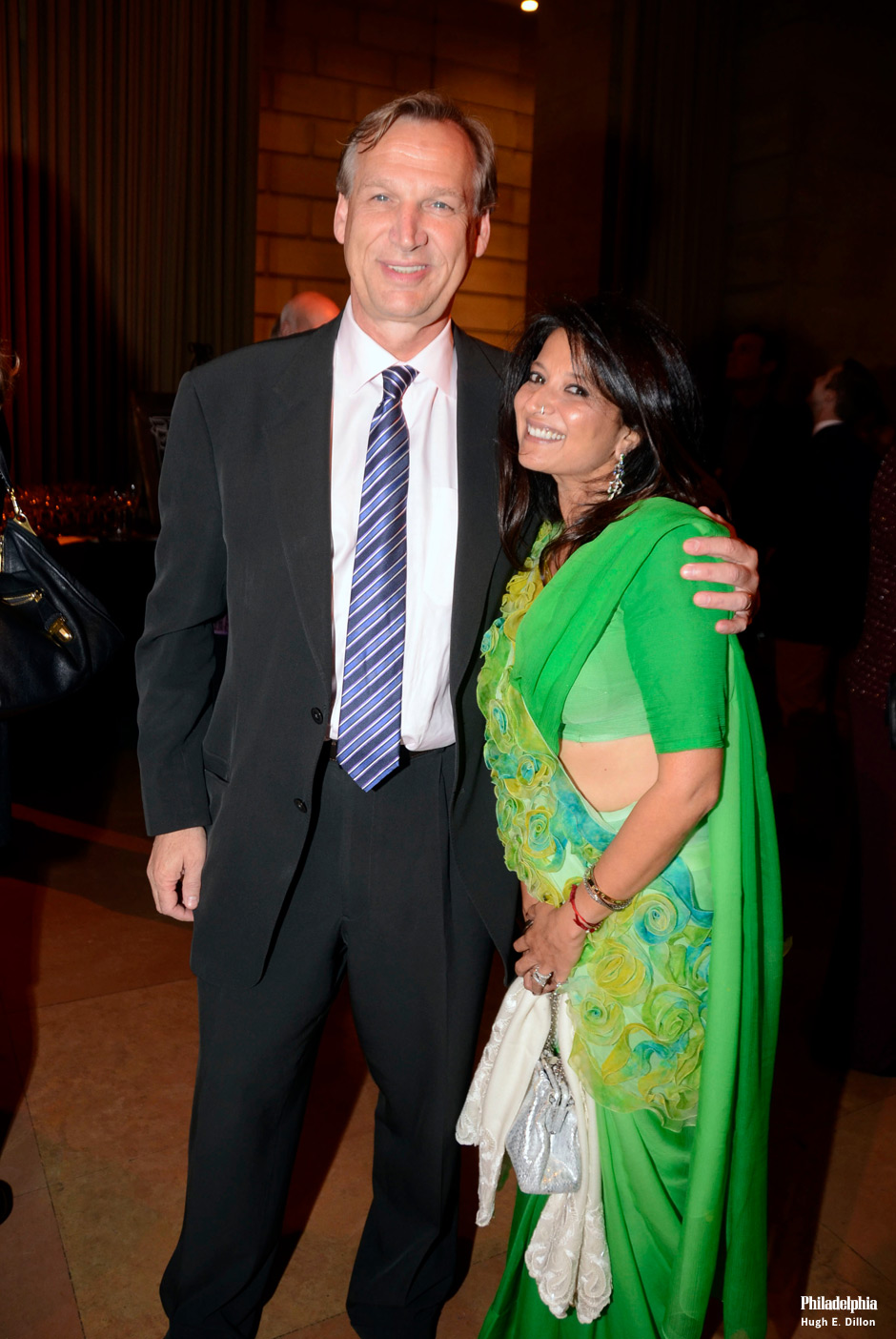 """On October 10, 2013, the Young Friends of the Philadelphia Museum of Art and Timothy Rub, Chief Executive Officer, (with guest Pia RoyChowdhury) hosted nearly 700 guests to celebrate the opening of Léger: Modern Art and the Metropolis, which runs through January 5, 2014. Guests enjoyed """"The City of Lights"""" themed evening, with cabaret music, light fare from STARR catering, cocktails including the Raspberry Beret as the museum was stylishly transformed to evoike the streets of Paris and the Metro."""