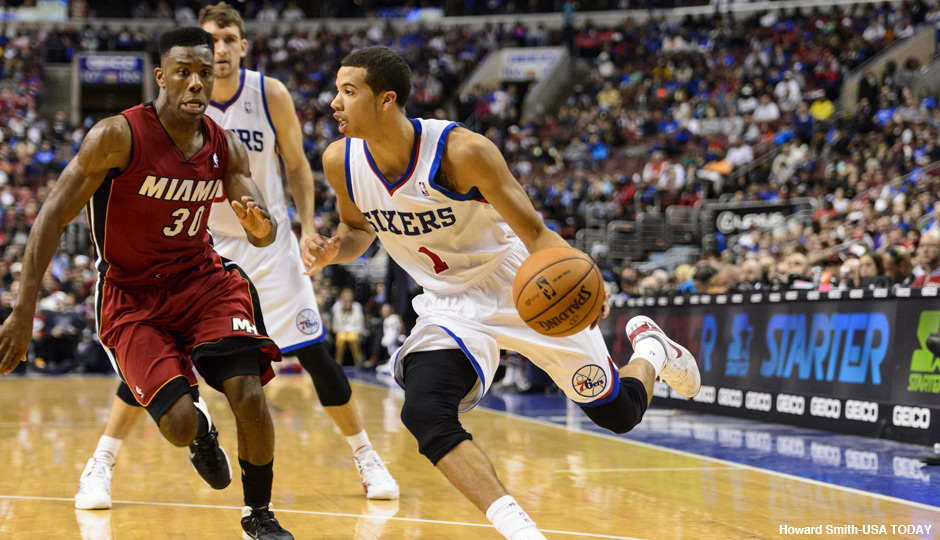 Philadelphia 76ers guard Michael Carter-Williams (1) is defended by Miami Heat guard Norris Cole (30) during the fourth quarter at Wells Fargo Center.
