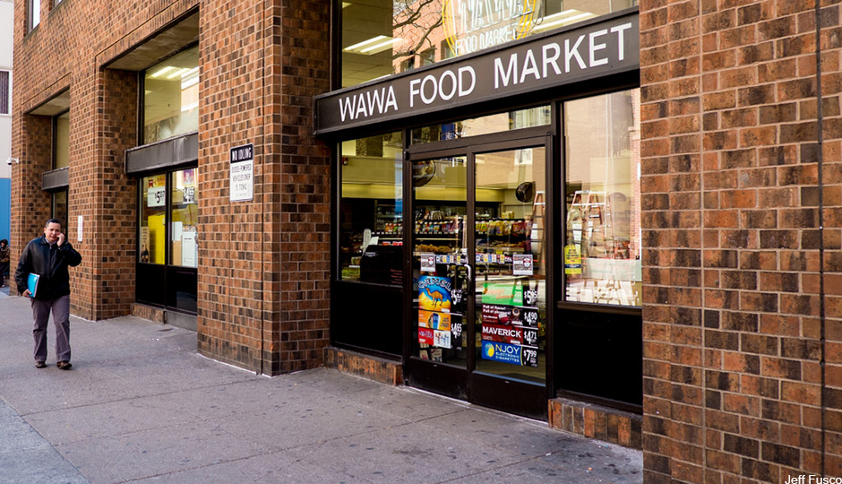 WAWA-with-guy-on-cell-phone-walking-towards-camera