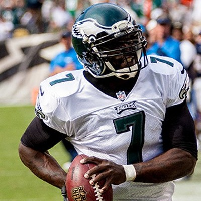 Mike Vick running with football on sideline