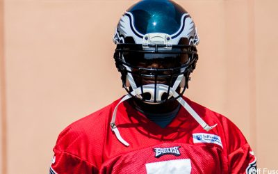 Eagles QB Mike Vick in red practice jersey