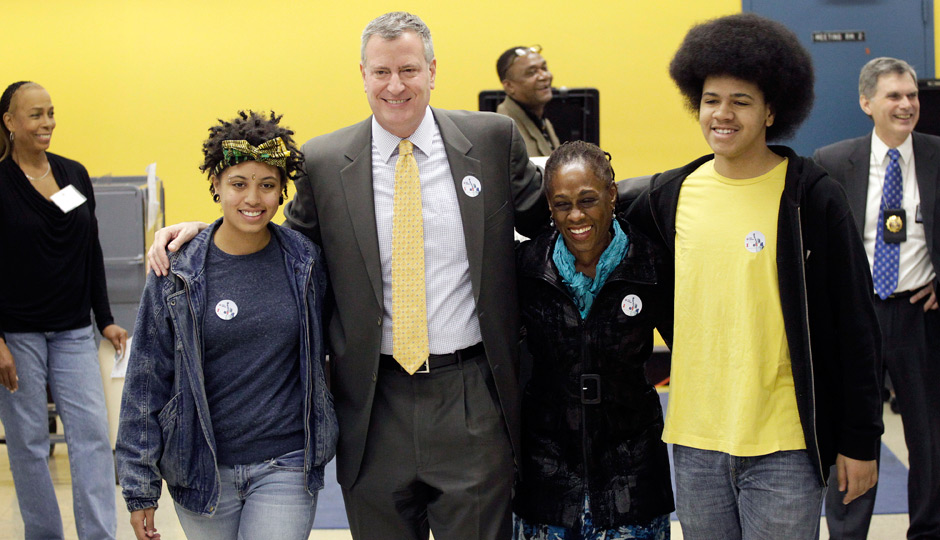 Democratic mayoral candidate Bill de Blasio embraces his family as they exit a polling station, Tuesday, Nov. 5, 2013 in the Park Slope neighborhood of the Brooklyn borough of New York. De Blasio is running against Republican candidate Joseph Lhota. From left, daughter, Chiara, de Blasio, wife Chirlane McCray and son, Dante. (AP Photo/Mark Lennihan)