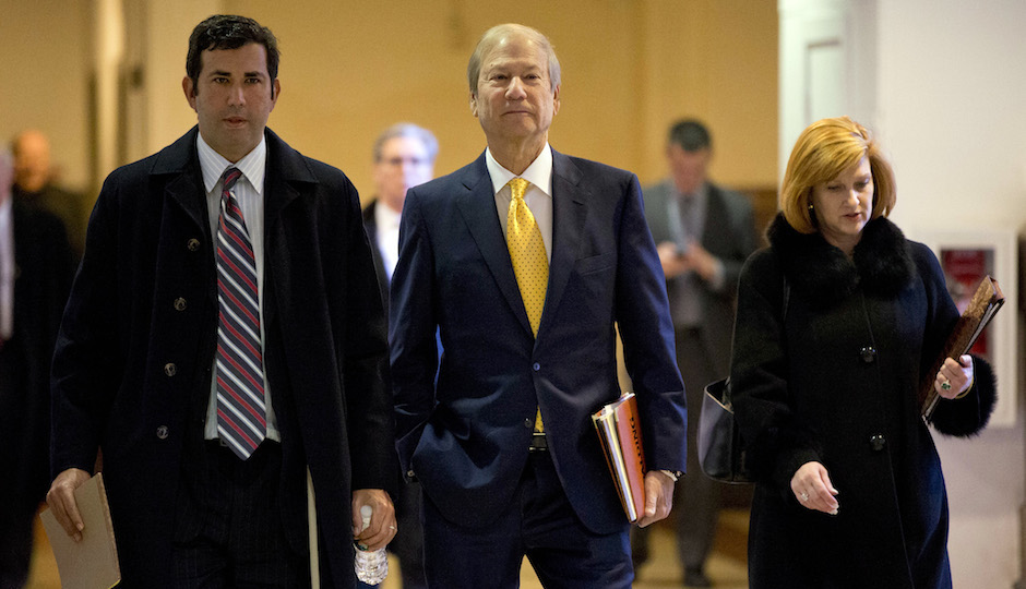 Businessman and co-owner of The Philadelphia Inquirer Lewis Katz, center, walks to Judge Patricia McInerney's courtroom, Wednesday, Nov. 13, 2013, at City Hall in Philadelphia. McInerney is scheduled to hear arguments over who should control The Philadelphia Inquirer and Philadelphia Daily News. (AP Photo/Matt Rourke)
