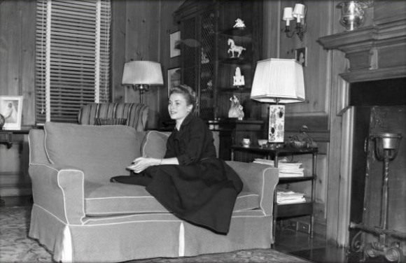 Grace sitting on a couch in her parents' East Falls home in 1954