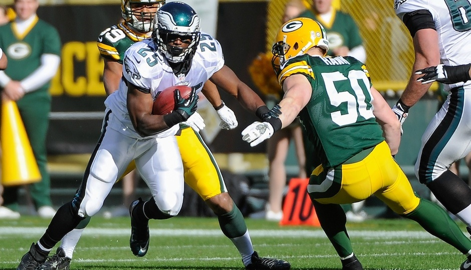 Nov 10, 2013; Green Bay, WI, USA; Philadelphia Eagles running back LeSean McCoy (25) runs with the ball past Green Bay Packers linebacker A.J. Hawk (50) in the first quarter at Lambeau Field. Mandatory Credit: Benny Sieu-USA TODAY Sports