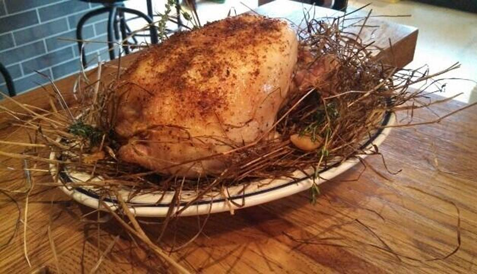 Chicken baked in hay.