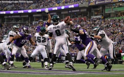 Dec 15, 2013; Minneapolis, MN, USA; Philadelphia Eagles quarterback Nick Foles (9) throws over Minnesota Vikings defensive tackle Kevin Williams (93) and defensive end Brian Robison (96) during the fourth quarter at Mall of America Field at H.H.H. Metrodome. The Vikings defeated the Eagles 48-30. Mandatory Credit: Brace Hemmelgarn-USA TODAY Sports