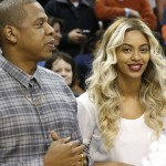 Jay-Z and Beyonce before the start of an NBA basketball game between the Oklahoma City Thunder and the Los Angeles Clippers in Oklahoma City on Nov. 21. (AP Photo/Sue Ogrocki)