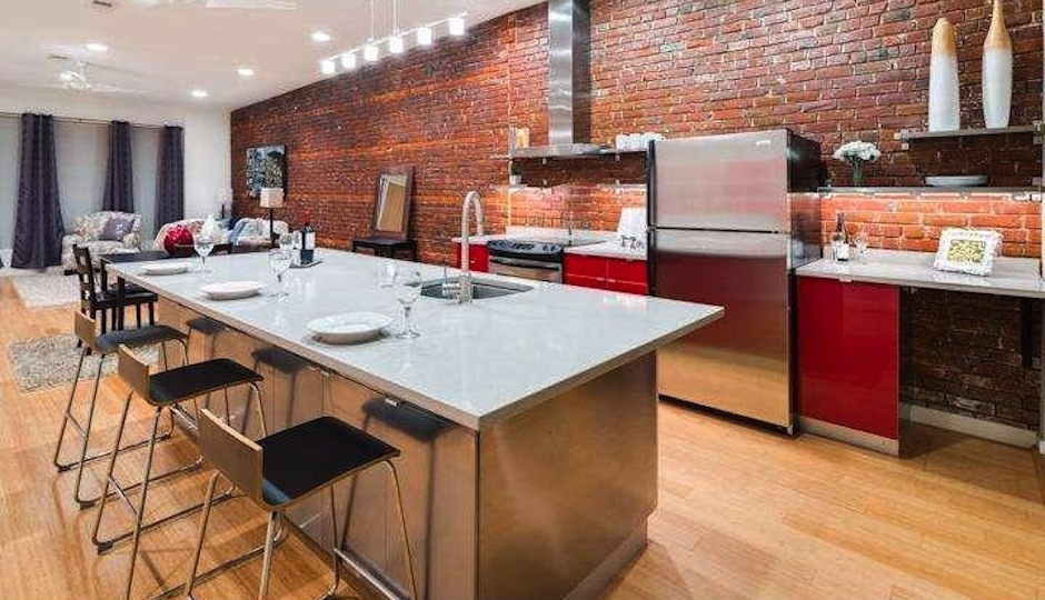 Converting Garage Into Kitchen industrial to residential conversion has glass-encased courtyard