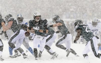 Nick Foles (9) hands off to running back LeSean McCoy (25) during the second quarter against the Detroit Lions at the Lincoln Financial Field Snow Bowl