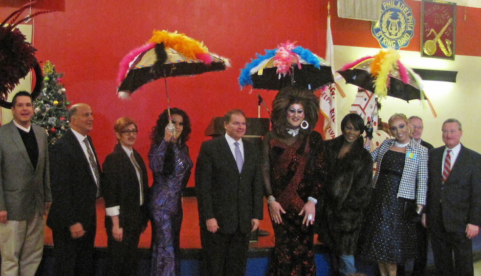 """At today's press conference. (L-R) Scott Brown, Director of Tourism for the Fancy Brigade Association; Councilman Mark F. Squilla; Dandy Lion; Crystal Electra; Leo Dignam, Mummers Parade Director; Brittany Lynn; Karen Von Say; Mistress M; Bill Burke, Vice President of the Philadelphia Fancy Brigade Association; and Councilman Jim Kenney were all smiles on Tuesday at the Mummers Museum, where the """"Miss Fancy"""" Brigade announced its plans to march up Broad Street once again as part of the 2014 Mummers Parade."""