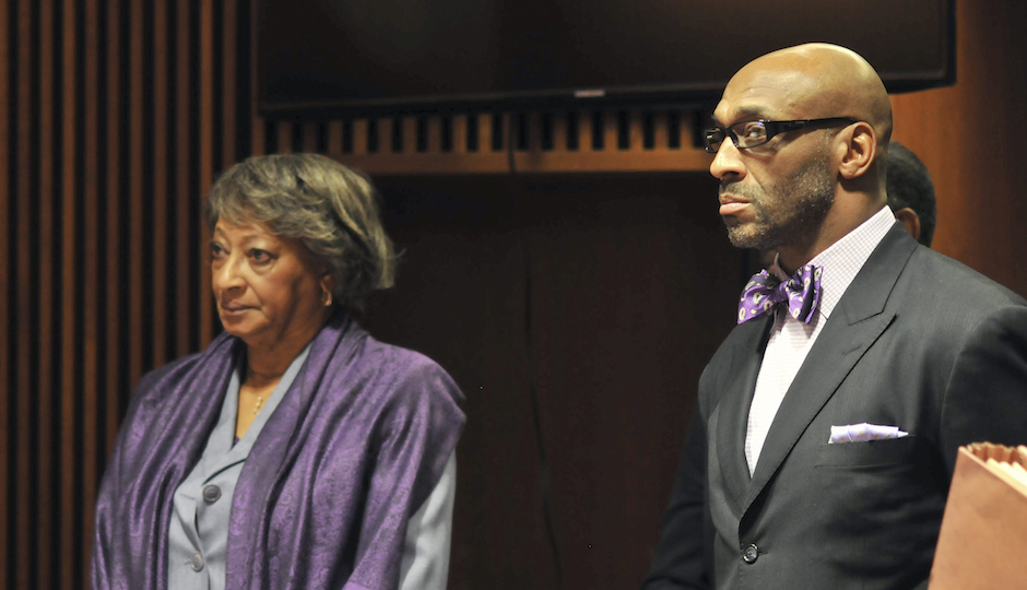 Former NFL football star, Irving Fryar, right, and his mother Allene McGhee appear before Judge James W. Palmer in Burlington County Superior Court in Mount Holly, N.J., Tuesday, Jan. 21, 2014, as they pleaded not guilty to charges that they conspired to steal more than $690,000 through a mortgage scam. State prosecutors allege Fryar's 80-year-old mother, Allene McGhee, of Willingboro, N.J., submitted false information to obtain five loans on her home within a six-day period. (AP Photo | Dennis McDonald)