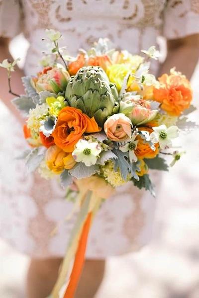 A seasonal bouquet by Jennie Love of Love 'n Fresh Flowers held by bride Carolyn Huckabay at her wedding last Spring. Photo by Peach Plum Pear Photo.