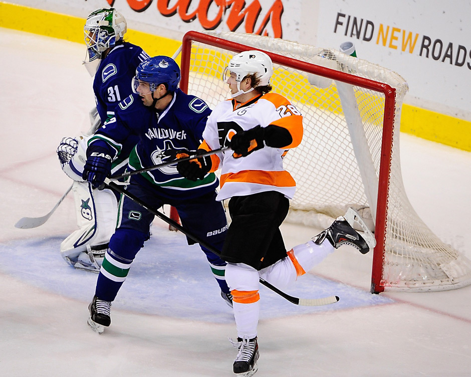 Dec 30, 2013; Vancouver, British Columbia, CAN; Philadelphia Flyers forward Claude Giroux (28) is defended by Vancouver Canucks defenseman Dan Hamhuis (2) during the third period at Rogers Arena. The Philadelphia Flyers won 4-3. Photo | Anne-Marie Sorvin-USA TODAY Sports