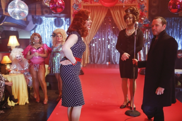 JInkx Monsoon with Blue Bloods star Donnie Wahlberg. Mimi Imfurst sits at the table in the background.