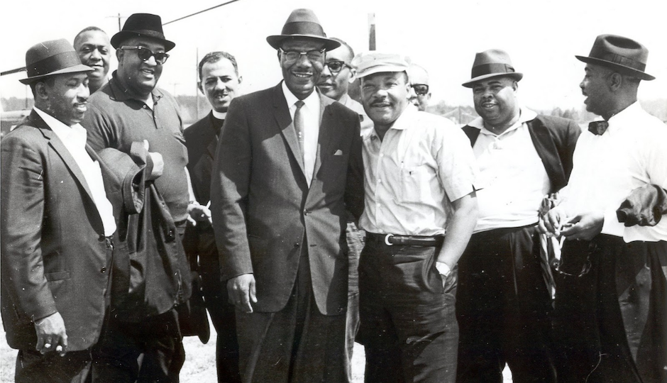 This photo — trom the Jack T. Franklin Photography Collection of the African American Museum in Philadelphia — shows Rev. King posing with the Philadelphia delegation of the Montgomery Civil Rights March in 1965.