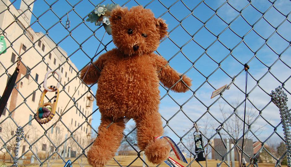 Teddy Bear on Fence at Oklahoma City National Memorial. Photo | Shutterstock.com