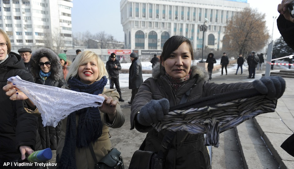 "This photo taken on Sunday, Feb. 16, 2014, shows women during a protest against the ban of lace underwear  in Almaty, Kazakhstan. A trade ban on synthetic underwear has Russia and her economic allies with their knickers in a twist. Post-Soviet consumers reacted with dismay to news that synthetic underwear will be banned within the Eurasian Economic Commission, which regulates a customs union between Russia, Belarus and Kazakhstan, from July 1. Consumer outcry against the restrictions reached a fever pitch after a Sunday protest in the capital of Kazakhstan, where thirty women wore lace underwear on their heads and shouted ""Freedom to panties!"" as they were shoved into police vehicles. (AP Photo/Vladimir Tretyakov)"