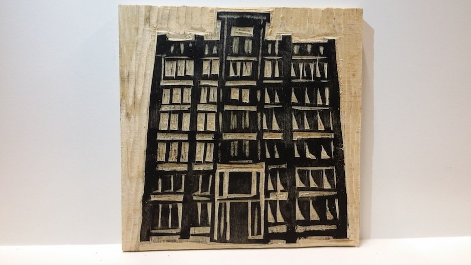 Etching of the Asian Arts Initiative's Gilbert Building on wood.