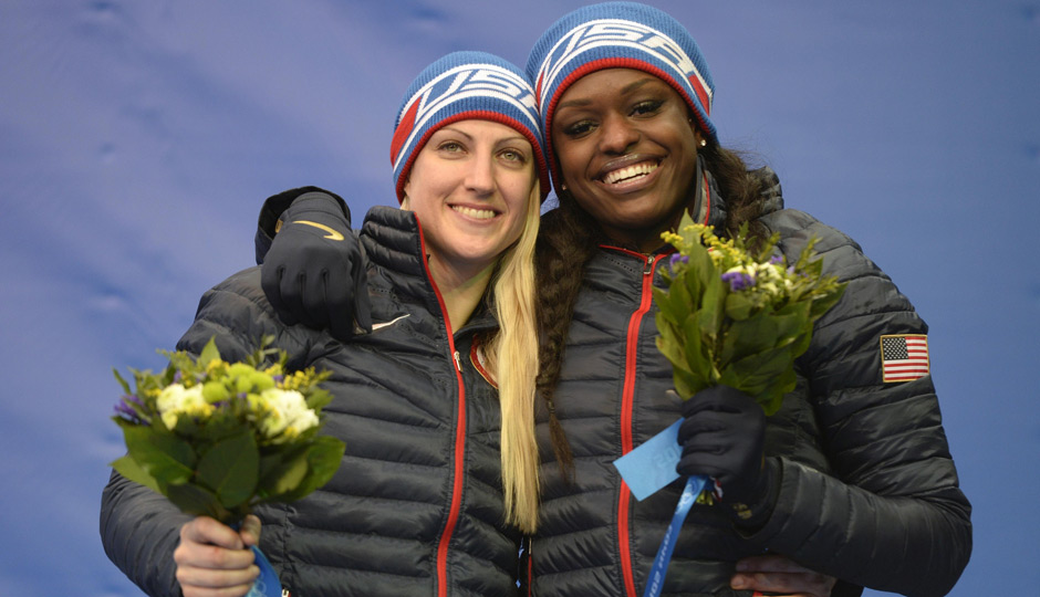 Jamie Greubel and Aja Evans (USA) celebrate winning bronze in women's bobsleigh during the Sochi 2014 Olympic Winter Games at Sanki Sliding Center. Photo | Jack Gruber-USA TODAY Sports