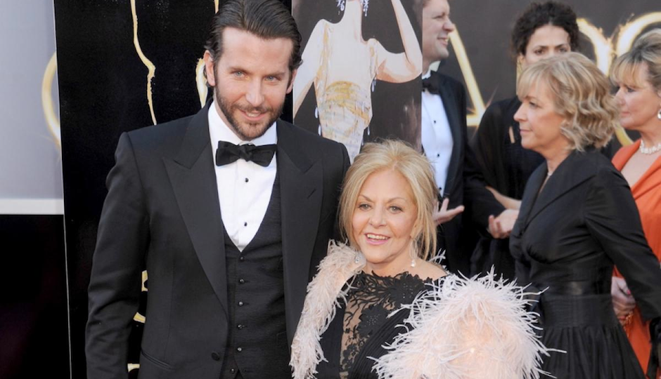 Cooper and his mom at last year's Academy Awards Ceremony. She must have had a hell of a time, because he's taking her again. Photo courtesy of New York Daily News.