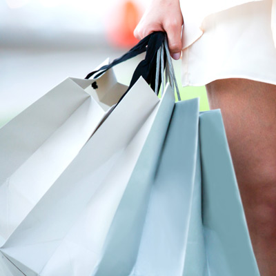 closeup-of-hand-with-shopping-bags