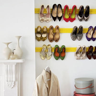 Shoes hanging from salvaged wood moldings? Perfection.