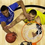 Kentucky's Marcus Lee, left, and Michigan's Jordan Morgan go after a rebound during the first half of an NCAA Midwest Regional final college basketball tournament game Sunday, March 30, 2014, in Indianapolis. Photo | Michael Conroy, Associated Press