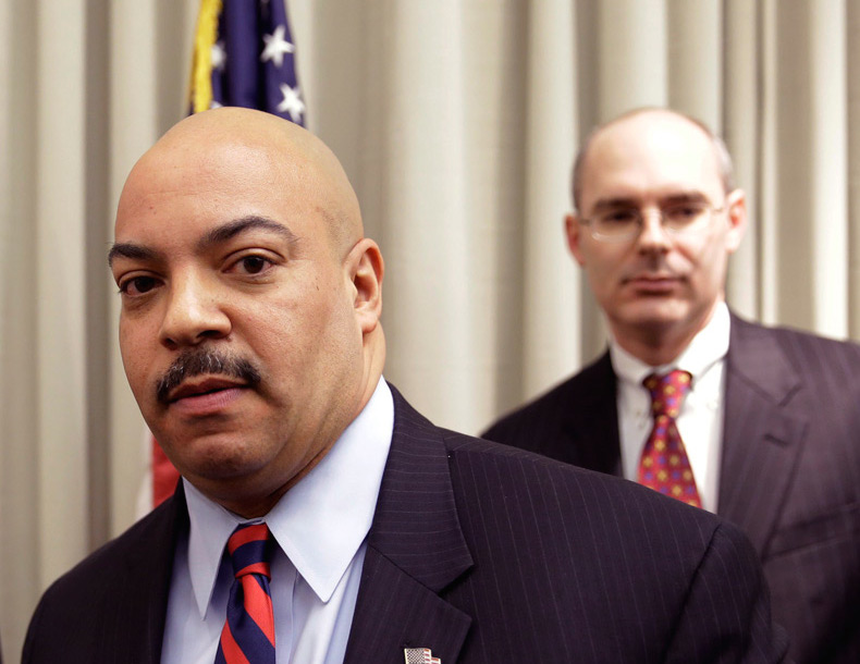 • Frank Fina, (pictured right, behind Seth Williams) who investigated the case and then moved to the D.A.'s office, used op-ed space to challenge Kane to be more forthcoming on her decision. Why didn't he use his op-ed space — or any public forum — to make the argument for what charges should've been brought, and why?