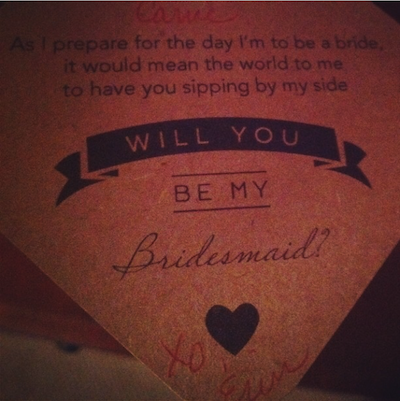 "The ""Will you be my bridesmaid?"" tag attached to my wine glass by my friend."