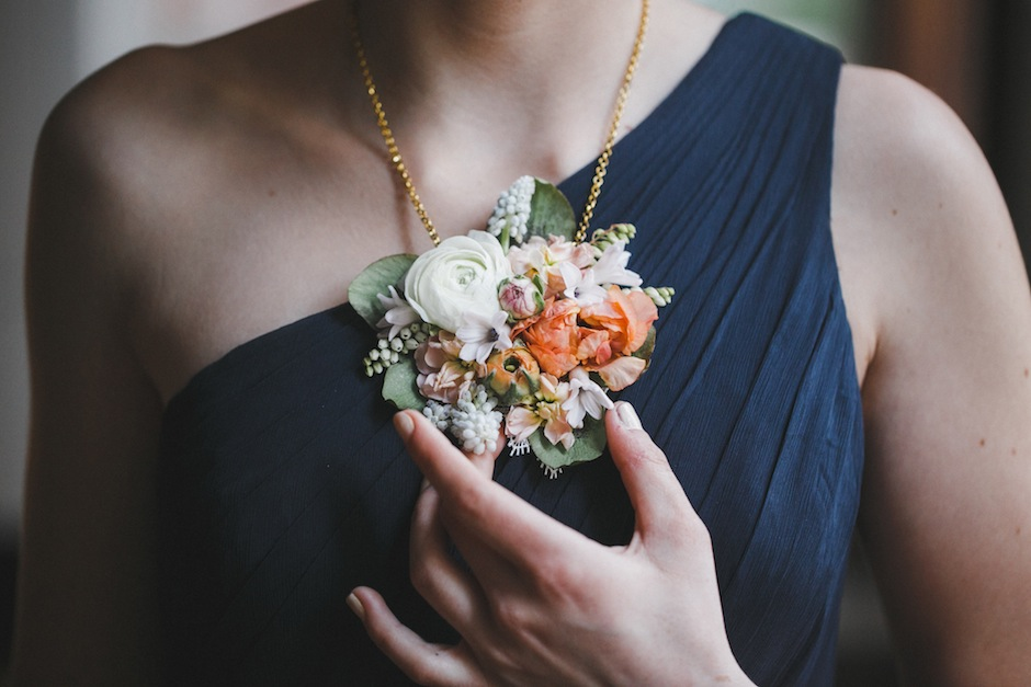 A fresh-flower necklace from Love 'n Fresh Flowers, photographed by Love Me Do Photography.