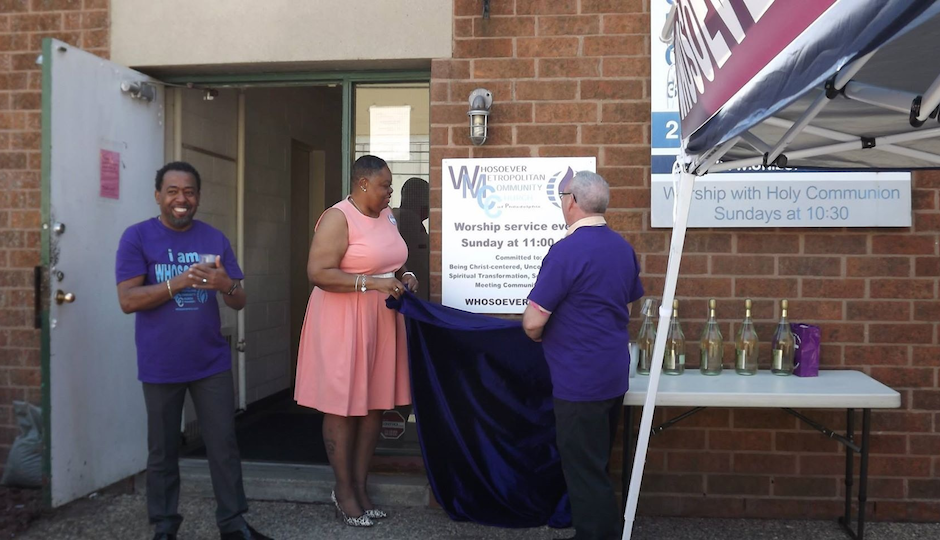 Rev. Jordan-Picket (far left) unveils the new church sign with Lay Delegate Renee Williams and Board Vice Moderator Arthur Martin Chester.