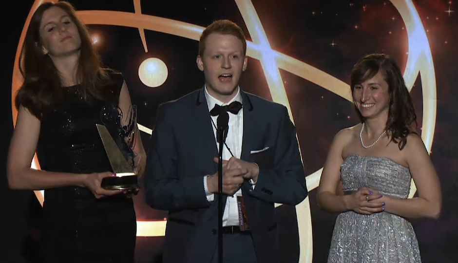 One of the Guys' Michael Busza (center) accepts the College Emmy for Best Series with his co-prodcuers TK (left) and TK (right).