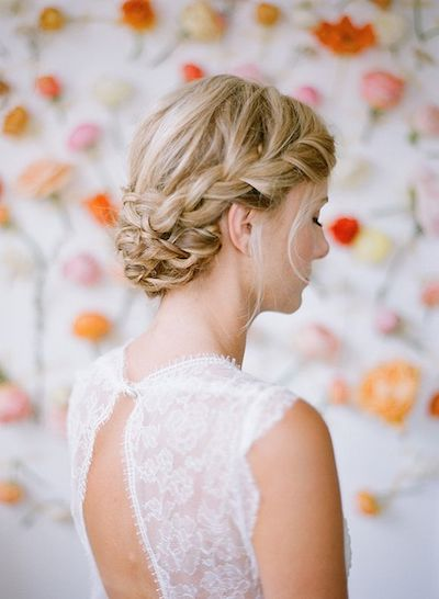 We cannot get enough of braided updos for brides right now.