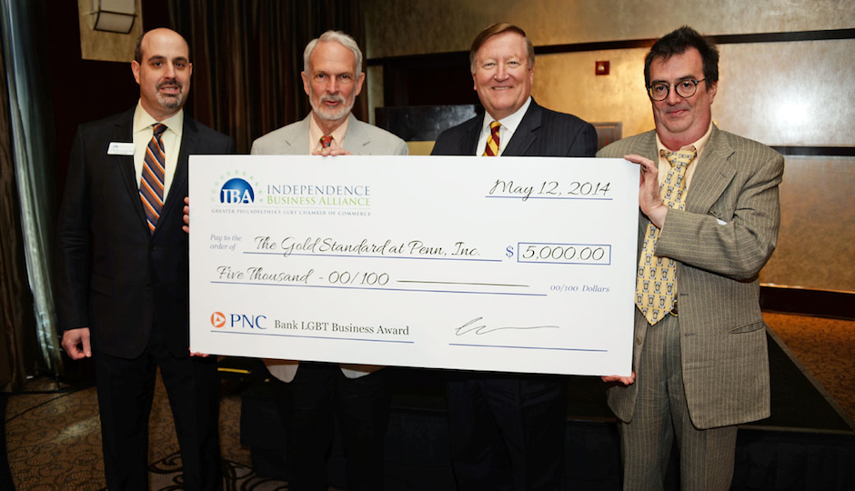 Last year's winners, Roger Halman (second from left) and Vincent Whittacre (far right) of The Gold Standard.  | Photo by HughE Dillon