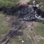 This aerial photo from Monday, June 2, shows wreckage from where a plane plunged down and erupted in flames during a takeoff attempt at Hanscom Field on Saturday night in Bedford, Mass. (AP Photo/The Boston Globe, David L. Ryan)